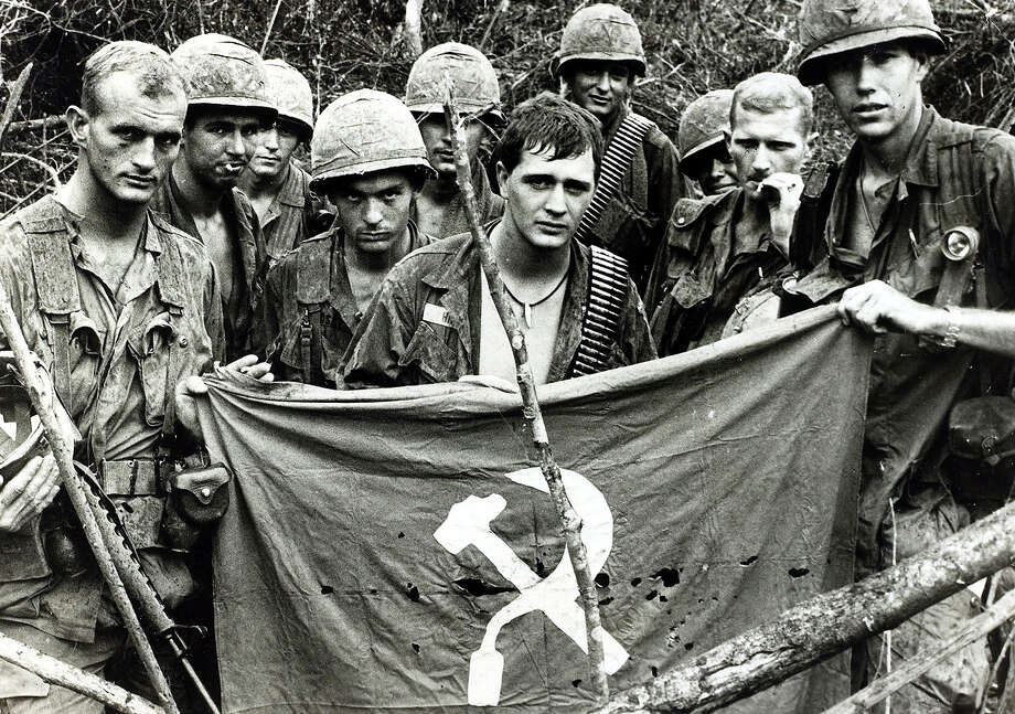 American soldiers with a captured communist flag, 1967. Photo: Rolls Press/Popperfoto, Popperfoto/Getty Images / Popperfoto