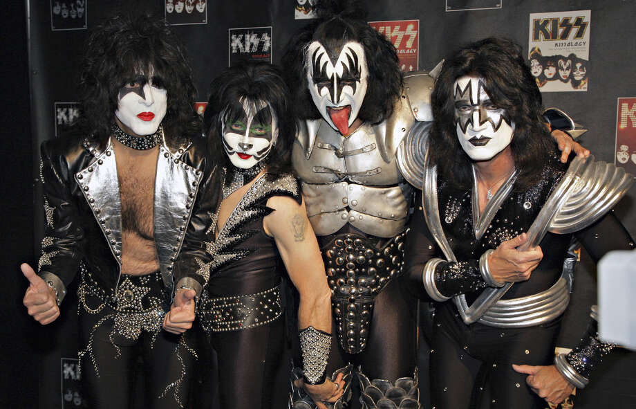 U.S. rock band Kiss, from left, Paul Stanley, Eric Singer, Gene Simmons and Tommy Thayer, poses with made up faces for the cameras during the press conference to promote the start of their KISS Alive/35 European Tour Thursday, May 8, 2008, which begins at the Arena Oberhausen, western Germany. (AP Photo/Volker Wiciok) ORG XMIT: VOW104 Photo: VOLKER WICIOK / AP