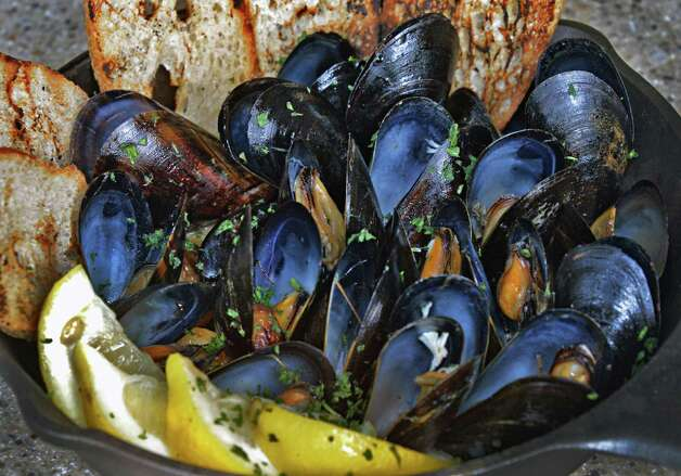 Sizzlin' mussels with crostini at Chef's Grill  inside Price Chopper's Market Bistro Friday July 25, 2014, in Colonie, NY.  (John Carl D'Annibale / Times Union) Photo: John Carl D'Annibale / 00027907A