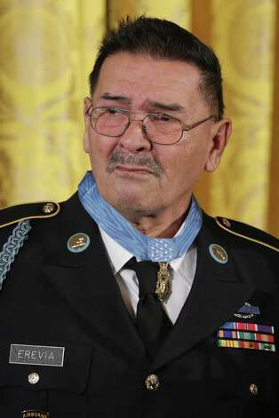 Sergeant Santiago Jesus Erevia 1946-Vietnam WarSergeant, U.S. Army, Company C, 1st Battalion, 501st Infantry, 101st Airborne DivisionMay 21, 1969, Tam Ky, VietnamFor conspicuous gallantry and intrepidity at the risk of his life above and beyond the call of duty:  Specialist Four Santiago J. Erevia distinguished himself by acts of gallantry and intrepidity above and beyond the call of duty while serving as a radio telephone operator in Company C, 1st Battalion (Airmobile), 501st Infantry, 101st Airborne Division (Airmobile) during search and clear mission near Tam Ky, Republic of Vietnam on May 21, 1969. After breaching an insurgent perimeter, Specialist Four Erevia was designated by his platoon leader to render first aid to several casualties, and the rest of the platoon moved forward. As he was doing so, he came under intense hostile fire from four bunkers to his left front. Although he could have taken cover with the rest of the element, he chose a retaliatory course of action. With heavy enemy fire directed at him, he moved in full view of the hostile gunners as he proceeded to crawl from one wounded man to another, gathering ammunition. Armed with two M-16 rifles and several hand grenades, he charged toward the enemy positions behind the suppressive fire of the two rifles. Under very intense fire, he continued to advance on the insurgents until he was near the first bunker. Disregarding the enemy fire, he pulled the pin from a hand grenade and advanced on the bunker, leveling suppressive fire until he could drop the grenade into the bunker, mortally wounding the insurgent and destroying the fortification. Without hesitation, he employed identical tactics as he proceeded to eliminate the next two enemy positions. With the destruction of the third bunker, Specialist Four Erevia had exhausted his supply of hand grenades. Still under intense fire from the fourth position, he courageously charged forward behind the fire e Photo: Chip Somodevilla, Getty Images / 2014 