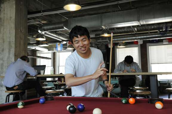 Software Engineer Intern and UC Berkeley student Yuxin Zhu plays pool in a recreation area at Yelp headquarters on July 29, 2014 in San Francisco, CA. Yelp turns 10 years old during the Aug. 3 weekend. CQ*