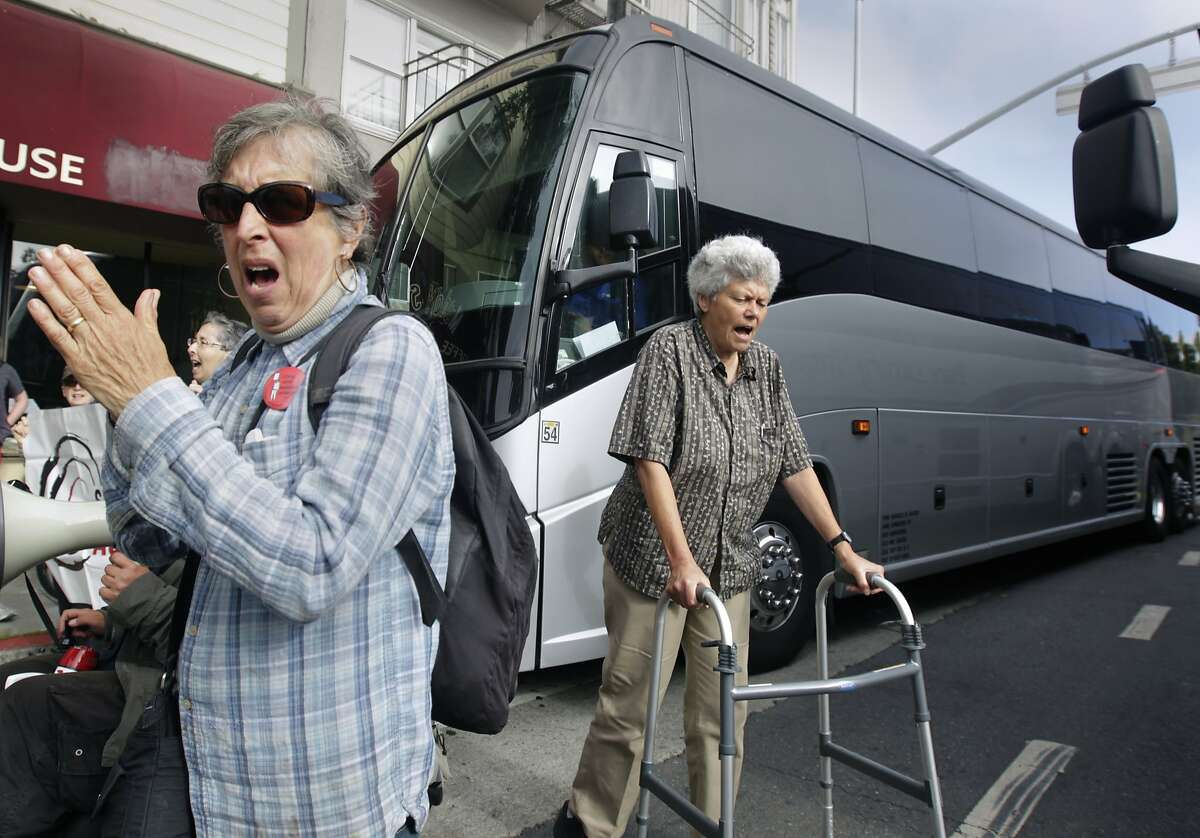 A group of seniors and disabled residents, protesting against the tech industry and its workers, block two shuttle buses picking up tech employess at 24th and Valencia streets in San Francisco, Calif. on Friday, Aug. 1, 2014.