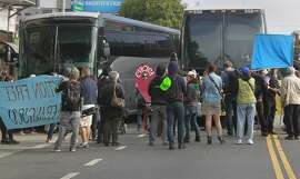 Seniors and disabled residents, protesting against the tech industry and its workers, block two shuttle buses picking up tech employess at 24th and Valencia streets in San Francisco, Calif. on Friday, Aug. 1, 2014.