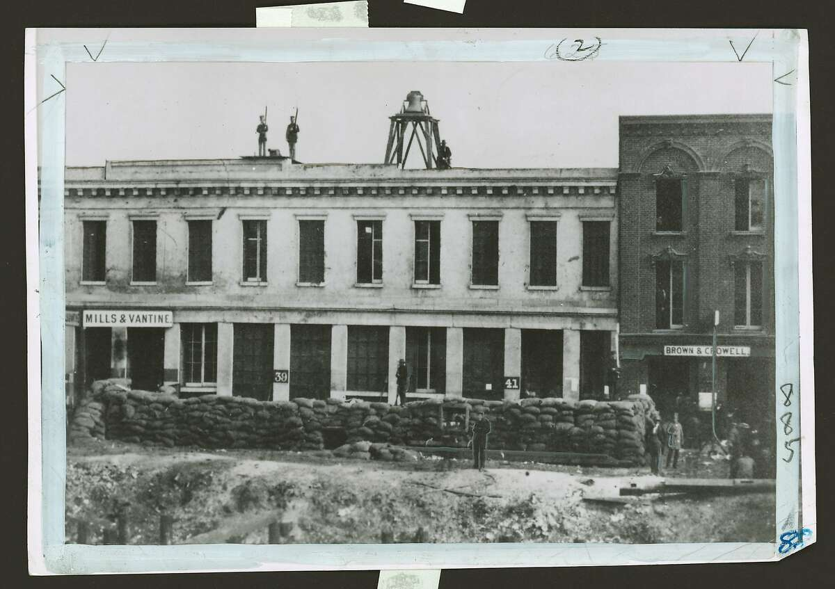 """This is a photo of """"Fort Gunnybags,"""" headquarters of the San Francisco Vigilance Committee of 1856. It was on Sacramento street between Davis and Front streets. It is one of many historic photos on exhibit at 1 Sacramento street."""