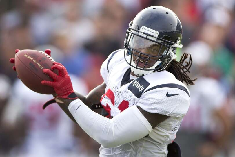 Texans free safety Kendrick Lewis (21) catches a football.