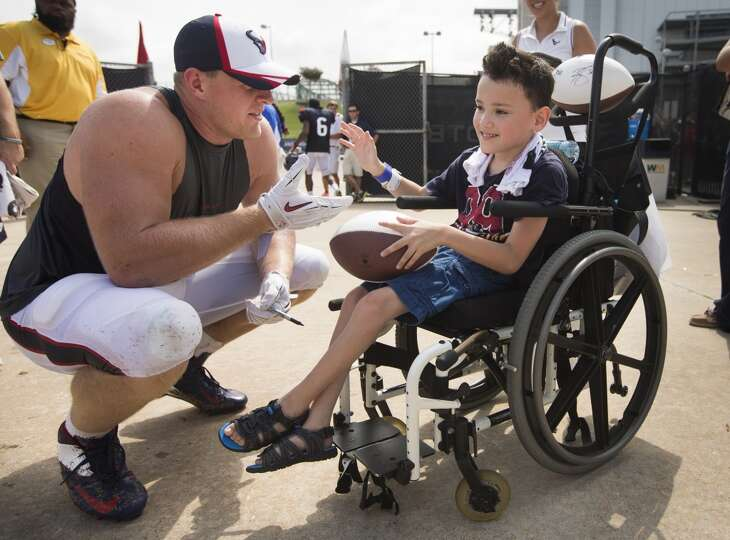 Day 6: August 1   Texans defensive end J.J. Watt, greets young fan