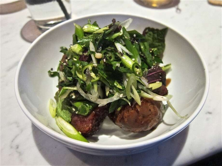 Nine-spice smoked brisket with herb salad, black garlic and roasted potatoes at Pax Americana. Photo: Alison Cook