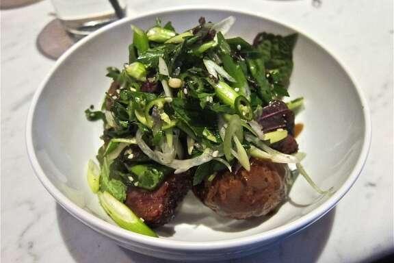Nine-spice smoked brisket with herb salad, black garlic and roasted potatoes at Pax Americana.