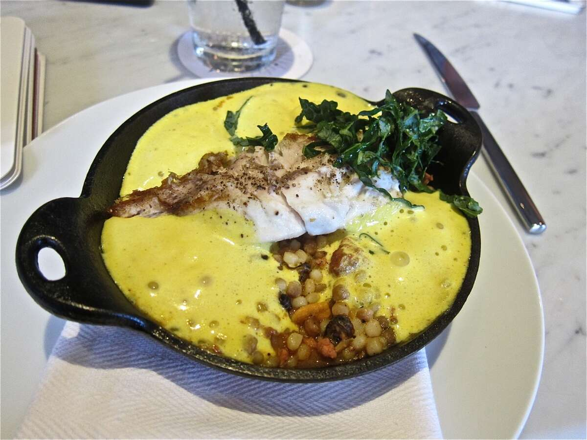 Snapper dish with rouille, preserved mussels and chopped kale at Pax Americana.