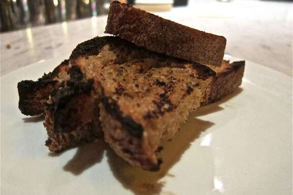 Grilled bread from Common Bond Bakery, served with the goat ricotta spread at Pax Americana.