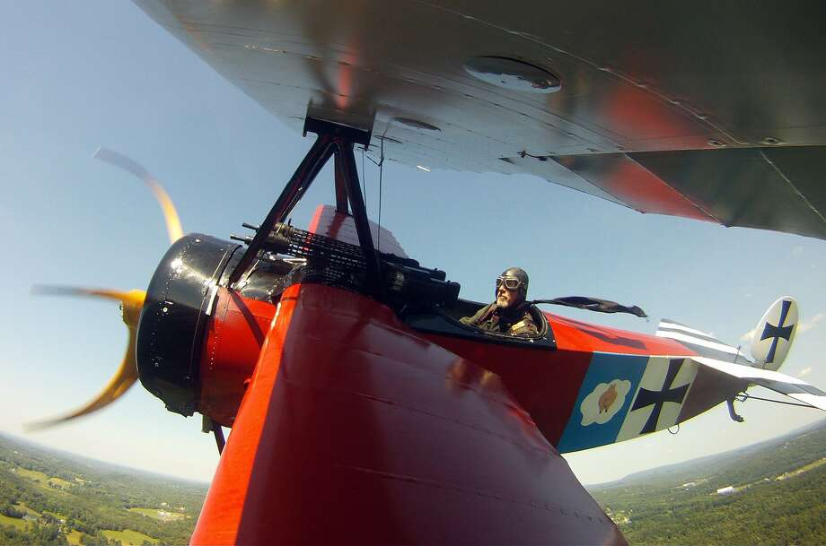 David King pilots a Fokker DR-1 reproduction plane during a show in Rhinebeck, N.Y. Photo: Mike Groll, Associated Press
