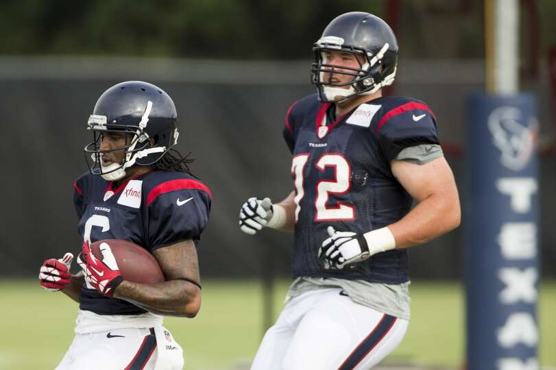 Texans wide receiver Joe Adams (6) and tackle Brice Schwab (72) run downfield after an Adams' catch.