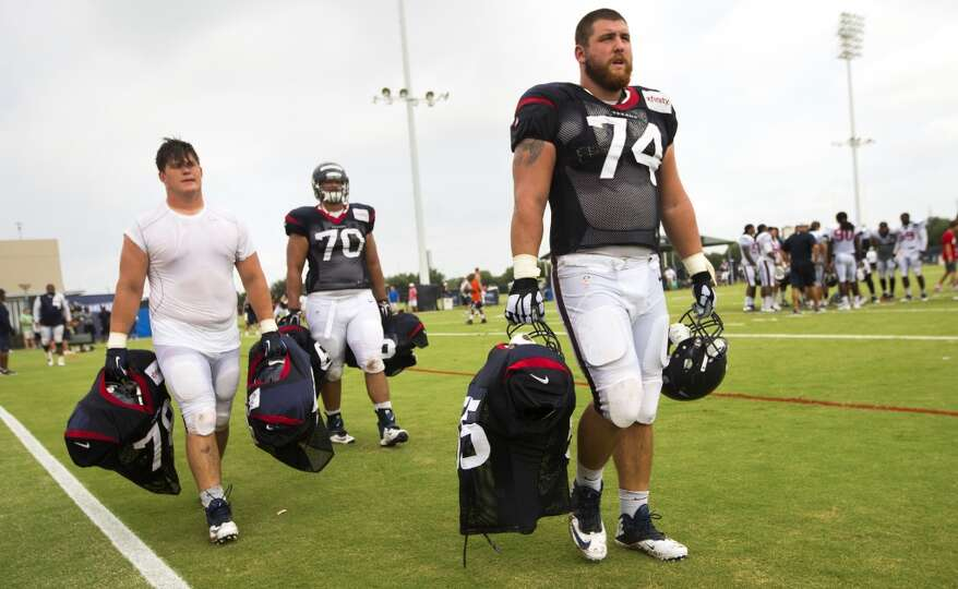 Texans rookies James Ferentz, left, Xavier Su'a-Filo (70) and Matt Feiler (74) walk off the practice