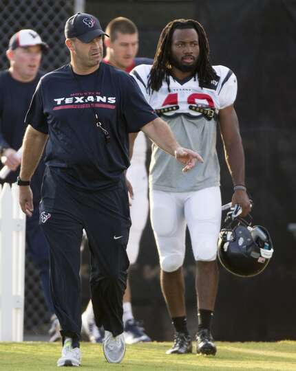 Texans head coach Bill O'Brien, left, walks onto the practice field with defensive back Marcus Willi