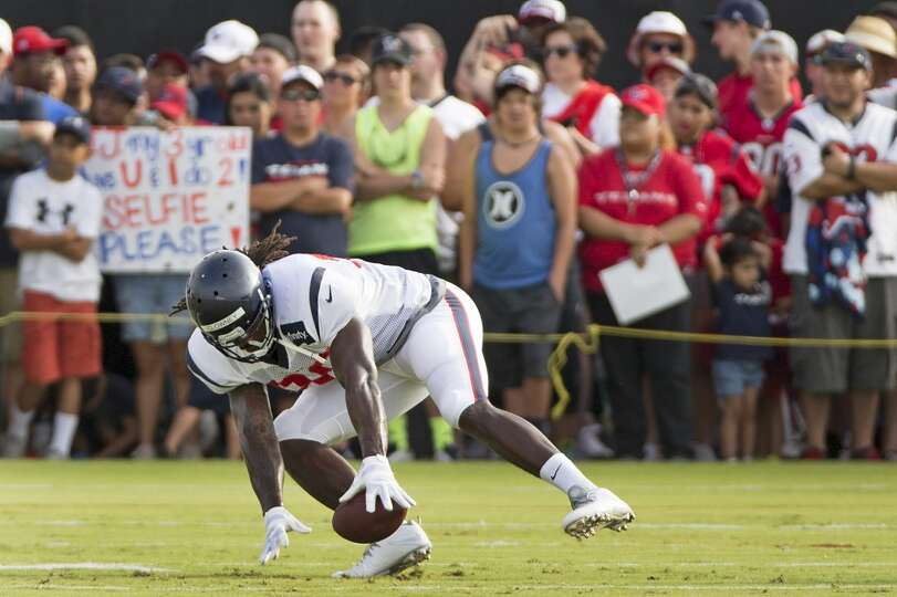 Texans linebacker Jadeveon Clowney goes after a loose ball during a fumble drill.