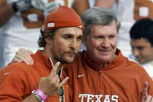 2005 season    Actor Matthew McConaughey poses with Mack Brown during a team photo at the Rose Bowl.