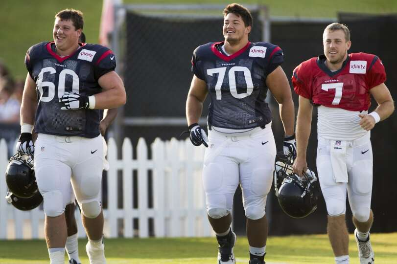 Texans center Ben Jones (60), guard Xavier Su'a-Filo (70) and quarterback Case Keenum (7) jog onto t