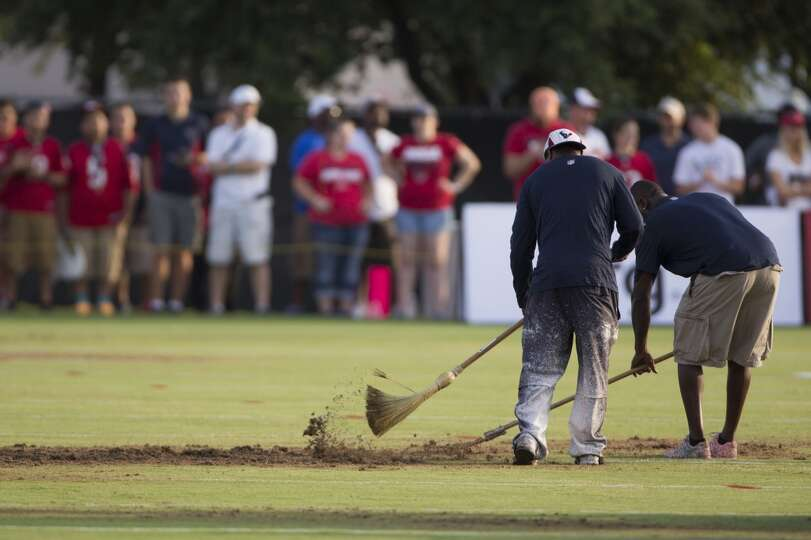 Texans grounds crew work on the practice field.