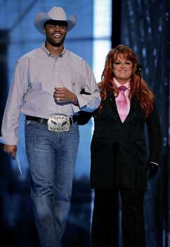 "Cowboy Troy: Country rap singer and former co-host of ""Nashville Star."" Seen here with country singer Wynonna Judd. Photo: Julie Jacobson, Associated Press / AP"