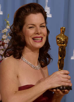 "Marcia Gay Harden: Actress, holding her 2001 Academy Award for best supporting actress in ""Pollock."" Also known for ""Into the Wild,"" ""Mystic River,"" ""Miller's Crossing"" and several TV movies. Photo: Reed Saxon, Associated Press / AP"