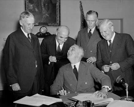 Morris Sheppard: Democrat (right) is best known for writing the Prohibition (18th) Amendment while serving nearly 40 years in U.S. House and Senate. Seen here with (from left) Secetary of War Henry L. Stimson, Rep. Andrew J. May, D-Ky., House Military Affairs Committee Chairman; U.S. President Franklin D. Roosevelt (sitting); and Gen. George C. Marshall, Army Chief of Staff, as Roosevelt signs the country's first peacetime draft law. Photo: Associated Press File Photo / AP1940