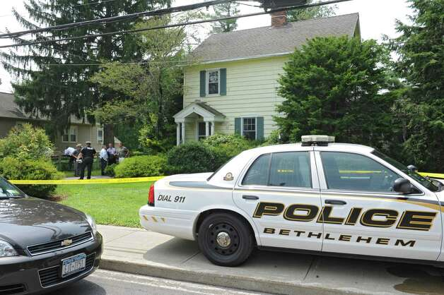 Police investigate a body that was found at this 63 Union Ave. home on Friday, Aug. 1, 2014 in Delmar, N.Y. (Lori Van Buren / Times Union) Photo: Lori Van Buren / 00028036A