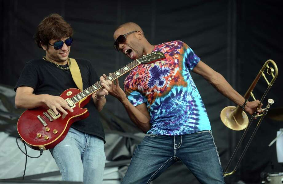 Pete Murano shreds on guitar with Trombone Shorty and Orleans Avenue Friday, Aug. 1, 2014, on the main stage at the annual Gathering of the Vibes music festival at Seaside Park in Bridgeport, Conn. Pete Murano Photo: Autumn Driscoll / Connecticut Post freelance