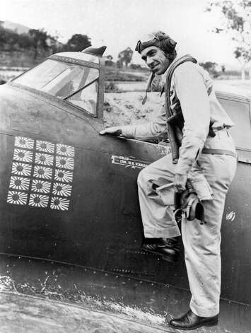 Colonel Neel Kearby, 1911-1944World War II, Colonel, U.S. Army Air Corps PlaceNear Wewak, New Guinea, 11 October 1943For conspicuous gallantry and intrepidity above and beyond the call of duty in action with the enemy, Col. Kearby volunteered to lead a flight of 4 fighters to reconnoiter the strongly defended enemy base at Wewak. Having observed enemy installations and reinforcements at 4 airfields, and secured important tactical information, he saw an enemy fighter below him, made a diving attack and shot it down in flames. The small formation then sighted approximately 12 enemy bombers accompanied by 36 fighters. Although his mission had been completed, his fuel was running low, and the numerical odds were 12 to 1, he gave the signal to attack. Diving into the midst of the enemy airplanes he shot down 3 in quick succession. Observing 1 of his comrades with 2 enemy fighters in pursuit, he destroyed both enemy aircraft. The enemy broke off in large numbers to make a multiple attack on his airplane but despite his peril he made one more pass before seeking cloud protection. Coming into the clear, he called his flight together and led them to a friendly base. Col. Kearby brought down 6 enemy aircraft in this action, undertaken with superb daring after his mission was completed.  Photo: National Museum Of The U.S. Air Force, Wikimedia Commons