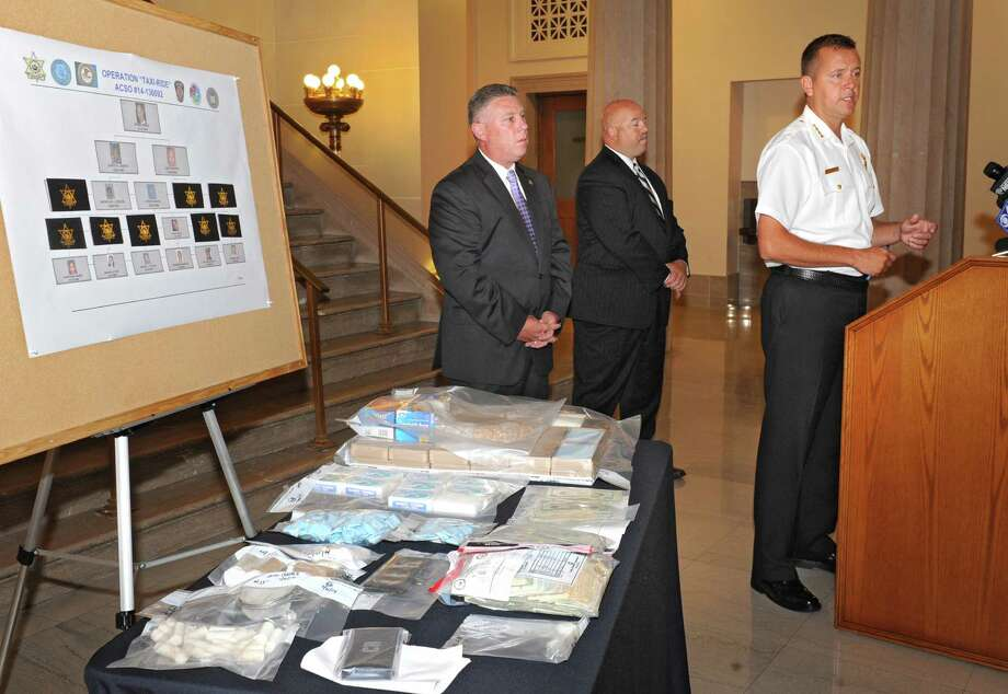 speaks about one of the department's largest heroin busts during a press conference Friday, Aug. 1, 2014, at the Albany County Court House in Albany, N.Y. Standing in the back are Assemblymember John McDonald III , left, and Lieutenant Robert Winn of the Colonie Police Department. (Lori Van Buren / Times Union) Photo: Lori Van Buren / 00028028A