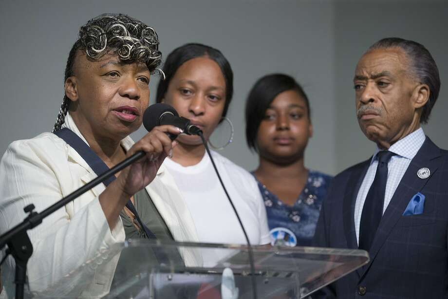 Gwen Carr, mother of Eric Garner, left, speaks alongside her daughter Ellisha Garner, center left, and the Rev. Al Sharpton, right, during a rally at the National Action Network headquarters, Saturday, July 26, 2014, in New York. Eric Garner, 43, died on Thursday, July 18, during an arrest in Staten Island, when a plain-clothes police officer placed him in what appeared be a choke hold while several others brought him to the ground and struggled to place him in handcuffs. (AP Photo/John Minchillo) Photo: John Minchillo, Associated Press