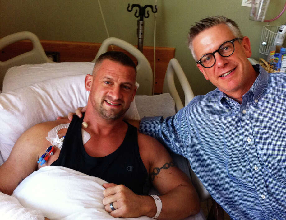Brian Koonz, right, visits his brother Kenny in the hospital on July 20, 2014. Photo: Contributed Photo / Danbury News Times  contributed