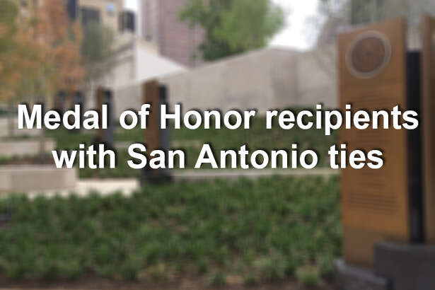 The plaques at the Medal of Honor River Portal near the Tobin Center for the Performing Arts are seen on Aug. 1, 2014.