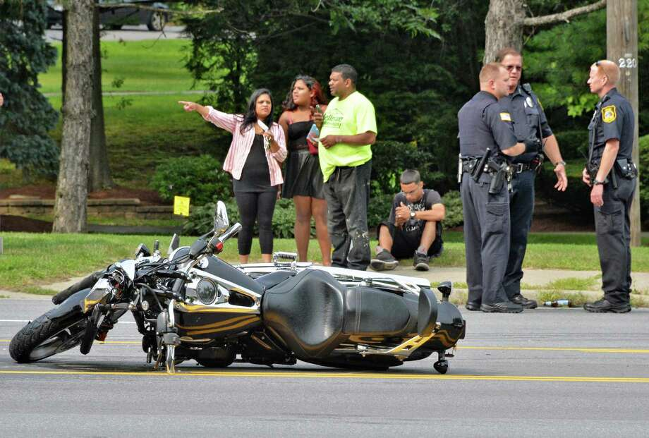 Niskayuna police at the scene of a car-motorcycle accident on Troy-Schenectady Road near Vrooman Avenue Friday August 1, 2014, in Niskayuna, NY.  (John Carl D'Annibale / Times Union) Photo: John Carl D'Annibale