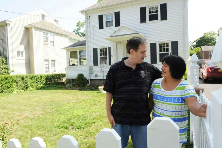 Chris and Denney  Kozicki at home on St Charles Avenue in Stamford, Conn. Chris grew up in this house in Springdale and moved back in when his parents died. Photo: Dru Nadler / Stamford Advocate Freelance