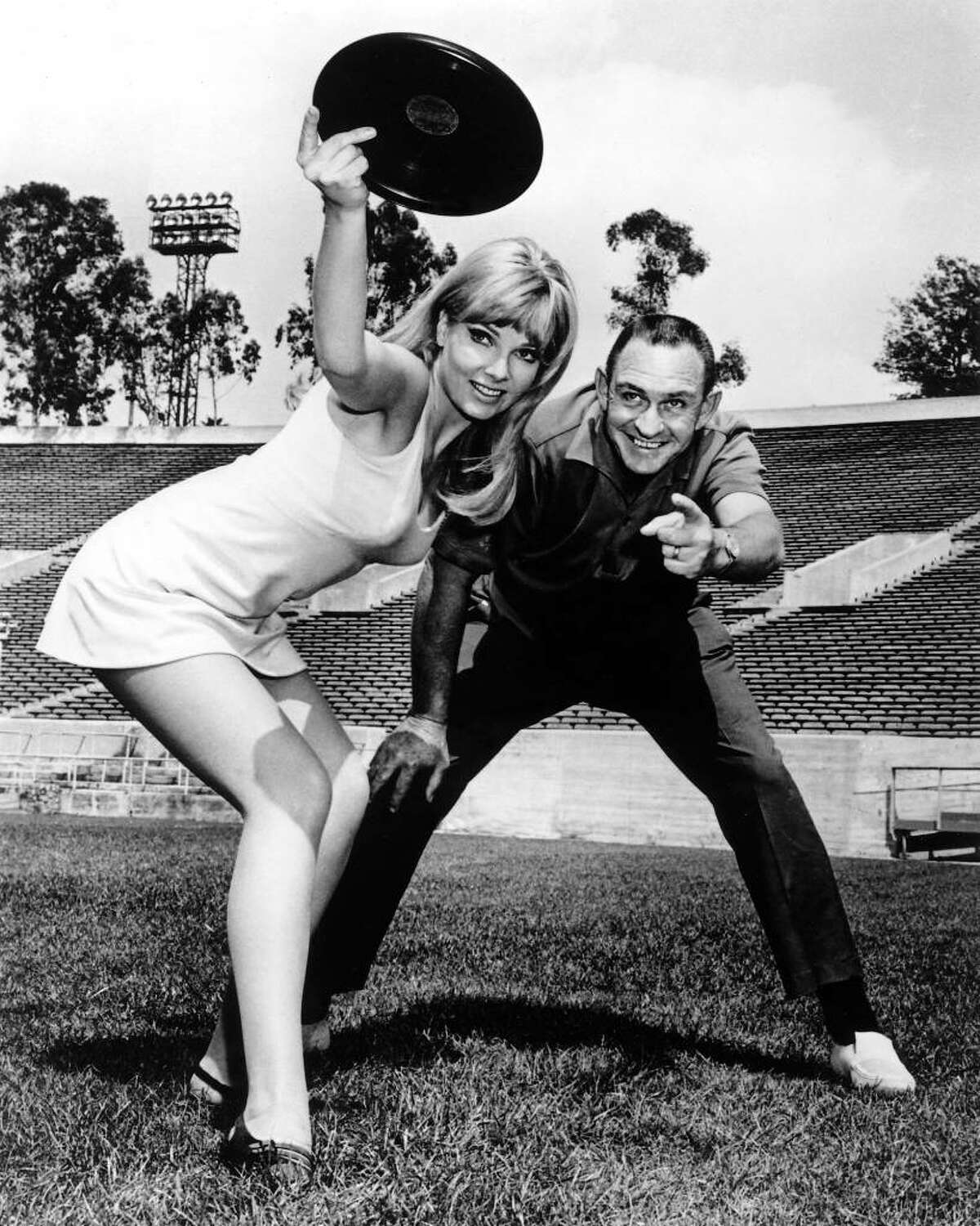 Contributed photo Frisbee inventor Fred Morrison, with a model, in a Wham-O 1967 publicity photo.