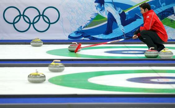 VANCOUVER, BC - FEBRUARY 18:  Jason Smith of the USA calls the shot during the men's curling round robin game against Denmark on day 7 of the Vancouver 2010 Winter Olympics at Vancouver Olympic Centre on February 18, 2010 in Vancouver, Canada.  (Photo by Jamie Squire/Getty Images) *** Local Caption *** Jason Smith Photo: Jamie Squire, Getty Images / 2010 Getty Images