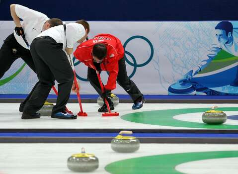 VANCOUVER, BC - FEBRUARY 18:  Members of the USA team compete during the men's curling round robin game against Denmark on day 7 of the Vancouver 2010 Winter Olympics at Vancouver Olympic Centre on February 18, 2010 in Vancouver, Canada.  (Photo by Jamie Squire/Getty Images) Photo: Jamie Squire, Getty Images / 2010 Getty Images