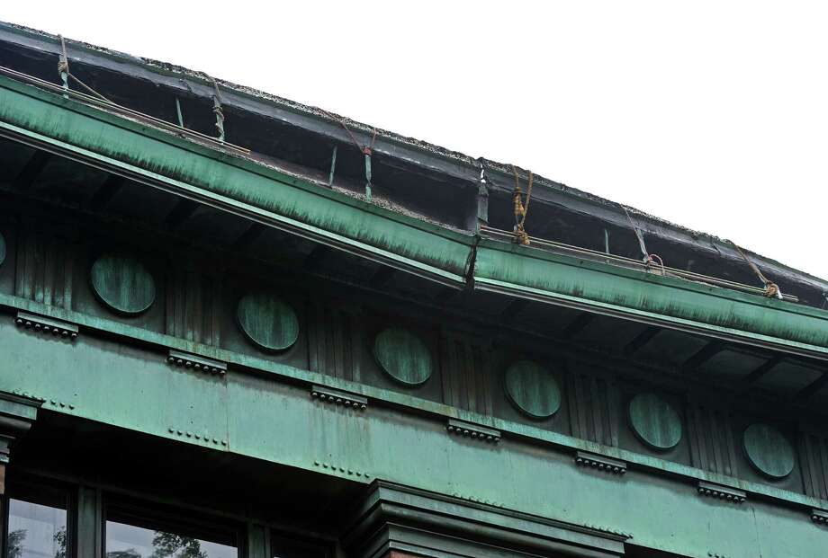 A copper gutter at Bridgeport's historic McLevy Hall came loose two weeks ago. City workers had shore up the heavy piece of the metal trough. Because the commanding building is on the National Register of Historic Places, city staff did not have the capacity to fix the problem. Photo: Cathy Zuraw / Connecticut Post