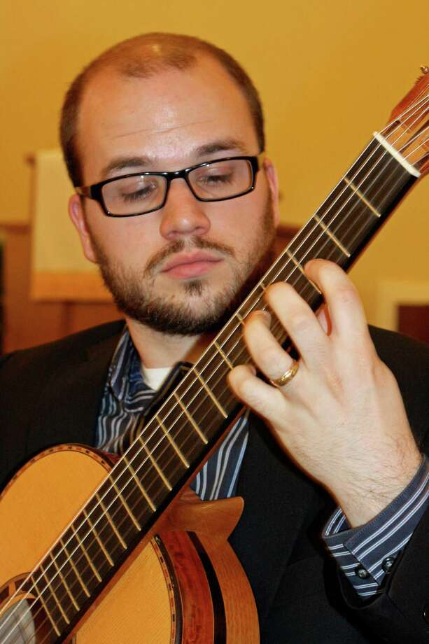 Trevor Babb, a guitarist based in New Haven, Conn., will perform as part of the summer classical music series at Bartlett Arboretum and Gardens in Stamford, Conn., on Sunday morning, Aug. 10, 2014, along with fellow guitarist Arash Noori. Photo: Contributed Photo / Stamford Advocate Contributed photo