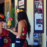 Servers at Noelani's Bar and Lounge donned special leis for the recent first anniversary celebration for the indoor-outdoor Hawaiian-themed restaurant in San Carlos, open daily except Monday.