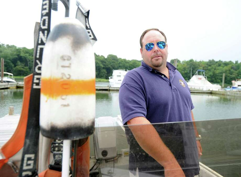 Lobsterman Gus Bertolf Jr. of Cos Cob aboard his 20-foot motorboat dockside on the Mianus River in Greenwich, Conn., Friday afternoon, Aug. 1, 2014. Bertolf Jr. said that the catch is way off from its peak years in the mid-90s but he is hopeful the lobsters will return if Long Island Sound and its waterways can be managed properly. Photo: Bob Luckey / Greenwich Time