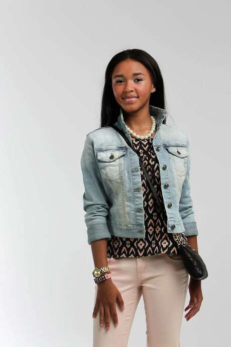 Phoenix Cheaux Pittman, 14, a freshman at Reagan High School, is wearing a CP Jeans, $17.99 (sale), Jessica Simpson denim jacket, $69, and top, $3, and Sperry loafers, $60; all from Dillard's. Her faux-pearl necklace, $58, Rachel Roy crystal-eye bracelet, $32, BCBGeneration Hope bracelet, $18, and Calvin Klein bag, $118, are from Macy's. Hair and makeup by Tree Vaello Photo: Mayra Beltran, Staff / © 2014 Houston Chronicle