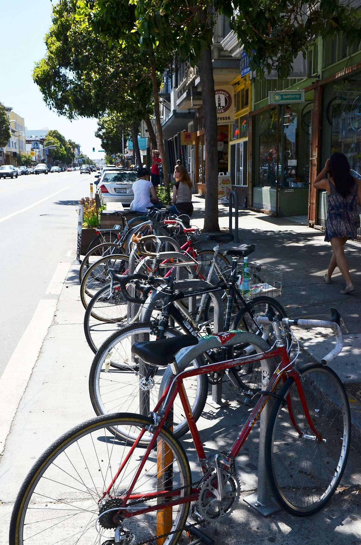 An on-street bike corral on Valencia Street comfortably holds 12 bikes and keeps the sidewalks clear for pedestrians. Requesting bike racks or bike corrals are two ways San Francisco bicyclists can directly improve their commute.