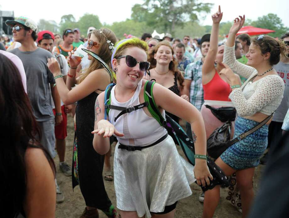 Emily Warner, of Lewes, Del., dances Friday, Aug. 1, 2014, at the annual Gathering of the Vibes music festival at Seaside Park in Bridgeport, Conn. Warner celebrated her 21st birthday Thursday at the Vibes. Photo: Autumn Driscoll / Connecticut Post freelance