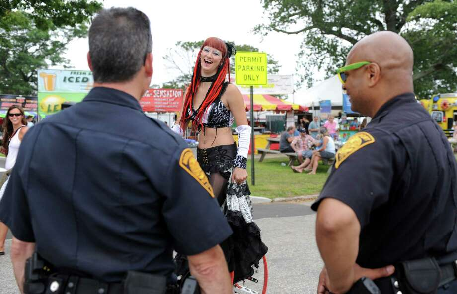 Sasha the Fire Gypsy talks with Bridgeport Police officers Friday, Aug. 1, 2014, at the annual Gathering of the Vibes music festival at Seaside Park in Bridgeport, Conn. Photo: Autumn Driscoll / Connecticut Post freelance
