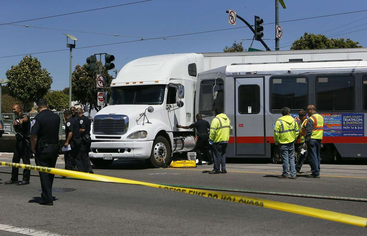 A collision between a big-rig truck and a Muni light rail vehicle at the intersection of Innes and 3rd streets shut down both the north and south bound lanes of 3rd street as emergency personnel responded to the scene in San Francisco, Calif. on Friday August 01, 2014.