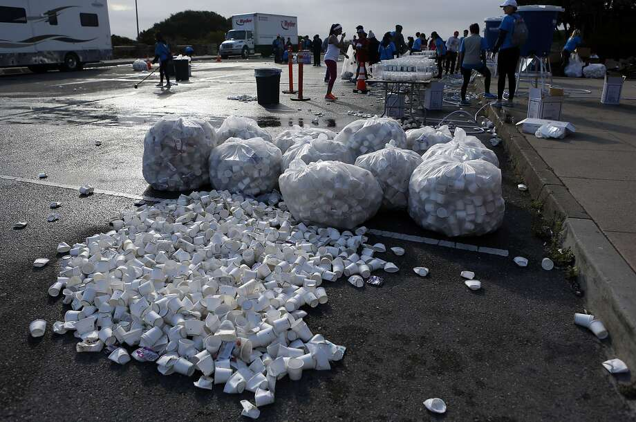 Runners' used cups are cleaned up at the Vista Point turnaround on the Golden Gate Bridge. Photo: Scott Strazzante, The Chronicle
