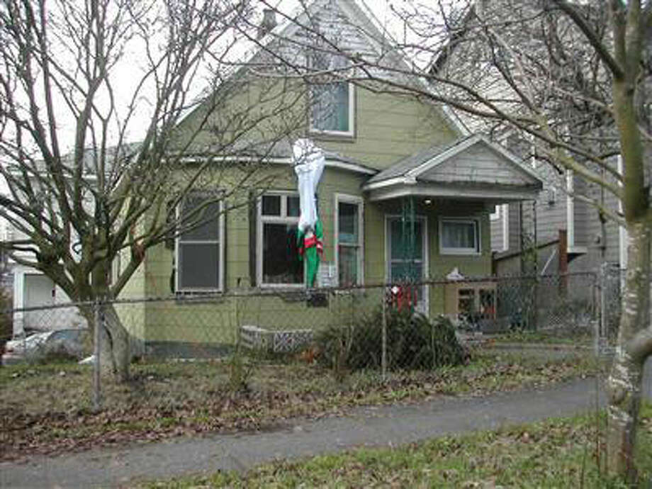 201 15th Ave., Seattle – One of eight properties owned by Clyde Yancey slated to be auctioned off to pay his $2.1 million debt for a series of code violations. Photo: Assessor's Office