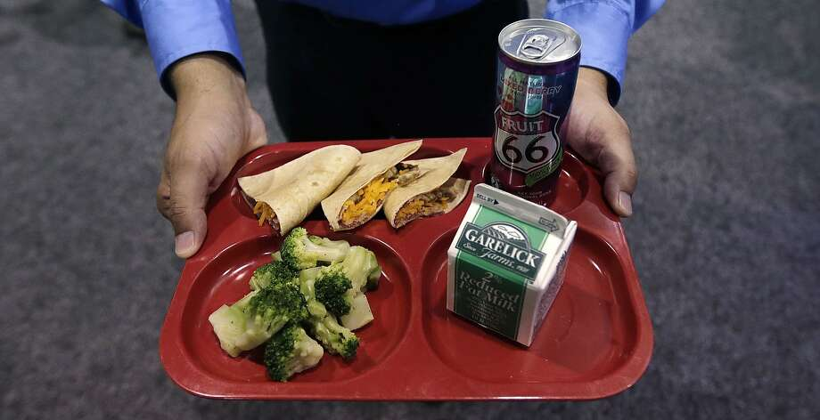 School lunches, like this one with whole wheat tortilla tacos, broccoli, juice and milk, must follow federal nutrition rules. Photo: Charles Krupa, Associated Press
