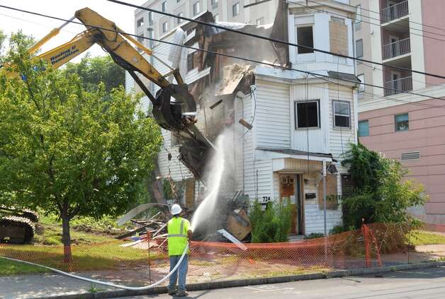 The house at 722 Eastern Ave. is demolished on Friday, Aug. 1, in Schenectady. (John Carl D'Annibale / Times Union) Photo: John Carl D'Annibale, Albany Times Union